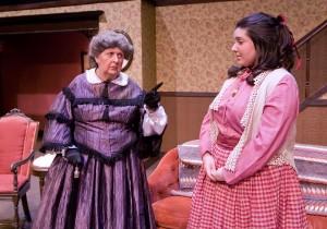 Aunt March shakes her finger at Meg