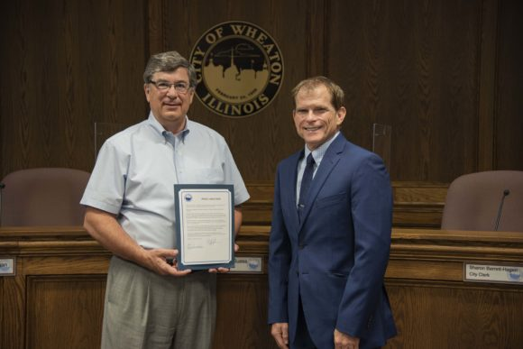 Wheaton Mayor Philip J. Suess Signs Proclamation for WDI's 90th Year